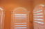 Plantation shutters on windows in this unit