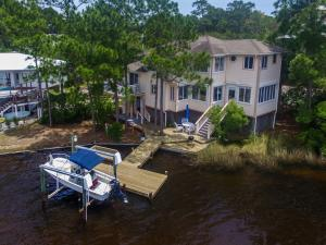 Spectacular home with 150' on a rare coastal dune lake