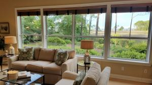 Living room views to the Bay across your five lots which are part of this property.