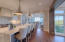 Kitchen with light reflecting marble counter tops