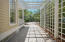 The deep driveway with a pleasing pergola that can easily be reconfigured through the DRB