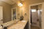 2nd and 3rd bedroom share dual vanity bath with separated water closet and shower/tub combo.