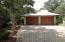 Neighbors with brick paver driveways