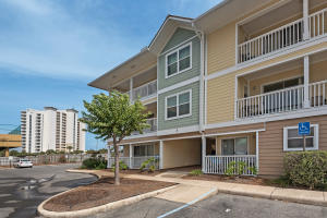 Ground floor unit located just across from the community pool
