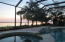 Relaxing by the pool, watching the sun set over the bay