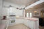 Kitchen is light and bright and opens to the Family Room