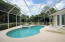 All French doors lead to the pool