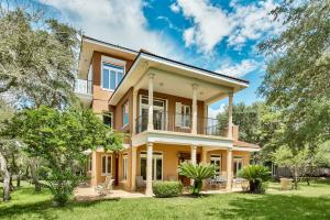 Phenomenal custom built 3-bedroom, 3.5 bath home in close vicinity to the Gulf of Mexico and offers Gulf views on the top level.