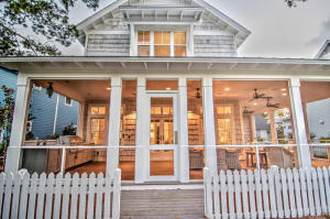Expansive screened wraparound porch complete with fireplace, Summer Kitchen, and media area.
