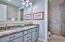 2nd floor Master Bath features double vanity with granite and shower with glass door.