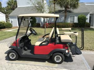 Club car in front of home