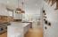 Beautiful open kitchen with reclaimed brick backsplash
