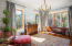 Sunroom surrounded with window walls on all sides