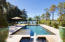 Outdoor amenities including a custom pool with uv water purifying system and white sand beach set this home in a class by itself