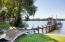 2 boat lifts (one covered), 2 jet-ski lifts, fish cleaning station, and white sand beach access