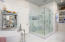 Luxurious master bath featuring marble and custom glass tile