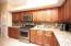 Granite counters and glass tile backsplash