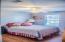 "Bedroom 2 has light grey walls and beautiful Acacia ""wood-look"" floors."