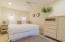 First level. Third guest bedroom includes en-suite bath and a private patio