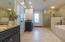 Third level. Master en-suite bathroom featuring double vanities, walk-in shower and garden tub
