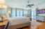 Third level. Master suite with bright, natural light, and direct access to private balcony