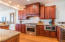 Second level. Kitchen, fully equipped with stainless steel appliances