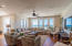 Second level. Living area, fully furnished providing ample natural lighting