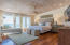Third level. Master Suite featuring planked, high ceilings