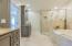 Third level. Master en-suite bathroom includes double vanities, walk-in shower and garden tub