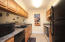Kitchen has dishwasher, refrigerator and oven