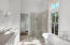 Gorgeous Carrear Marble Master Bath with large walk in shower, tub and vanity. Walk in Closet at the end of room