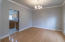 formal dining rm w/hdwd flooring, crown molding. located off the foyer.