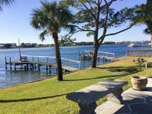 Grassy area perfect for picnics and watching boats pass by... and two private fishing docks..