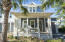 Adorable Florida Cottage elevation with one car garage on a quiet cul-de-sac street only steps to the neighborhood pool