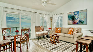 - Dining/living room and magnificent beach and ocean views – Enjoy the beach view no matter what you are doing