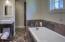 Oversized garden tub, walk-in closet and double vanities.