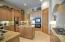 Custom cabinetry with accent lighting and granite countertops.