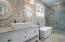 Master Bathroom with custom tile work, free standing soaking tub, and vessel basin