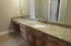 Beautiful counter tops with make-up station in upstairs bathroom.