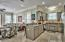 The kitchen features a beautiful tile backsplash, recessed lighting, lots of cabinet space, and stainless steel appliances.
