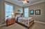 The windows look out onto natural preserve for relaxed living.
