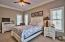 Peaceful views of the preserve make this the perfect bedroom to relax. There is also a large closet and guest bathroom.
