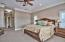 A very spacious room with recessed lighting and crown molding.