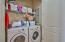 This home conveniently has a laundry room with full size washer and dryer that convey with this property.