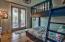 First floor bunk room w/access to rear patio & Jack & Jill bath.