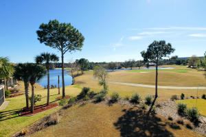 Enjoy sunsets and views of Regatta Bay's 15th & 16th holes from your covered balcony
