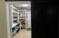 Walk -in pantry with roller door