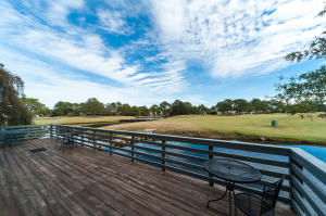 Expansive deck overlooks The Links golf course and the lagoon.