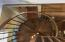 Spiral Hardwood Stairs down to Master Bedroom from Tower