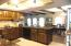 This view shows the large breakfast bar and more storage